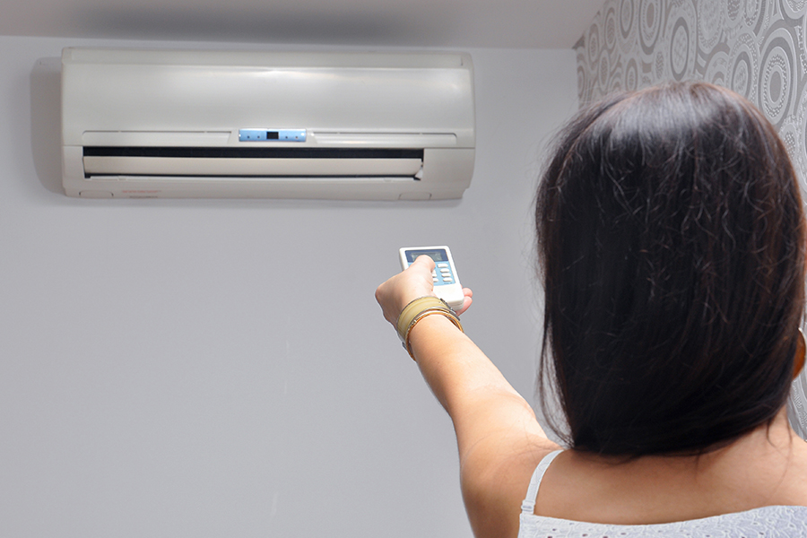 woman and ductless heat pump